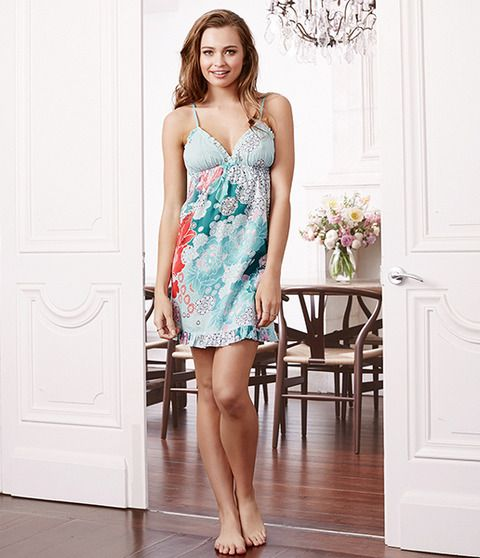 The classic beauty herself, the Marie-Antoinette is a chic, elegant style that exudes femininity.  This 100% cotton nightie has a floral print partnered with soft mint and turquoise tones. Marie Antoinette features thin and comfortable adjustable straps that allow movement and an easy-to-wear feel. Dainty frills fringe the chest and skirt to enhance the girly look of this garment. She is a classic, chic and feminine lightweight summer piece.