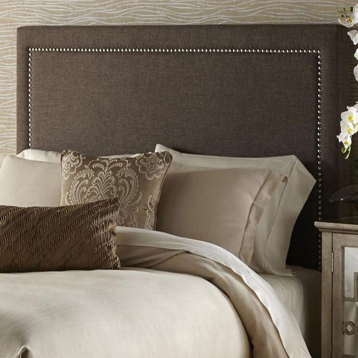 This transitional brown queen-size upholstered headboard is handcrafted for the ultimate in comfort and style. This plush upholstered headboard is generously padded and can be attached to most standard metal bed frames.