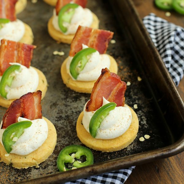 These Jalapeno Corn Cakes with Honey Whipped Goat Cheese and Bacon make an amazing appetizer!