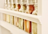 {DIY} Built-in Spice Rack. Love the natural colors of the spices against the all white cabinets.