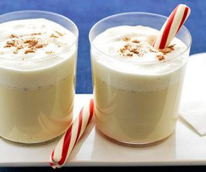 Cinnamon and vanilla ice cream make this Christmas party punch creamy and spicy. Embellish each serving with a candy cane.
