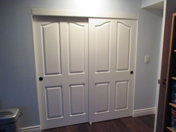 2 Panel / 2 Track Top Hung Hollow Core Bypass Closet Doors Installed In  Fullerton,