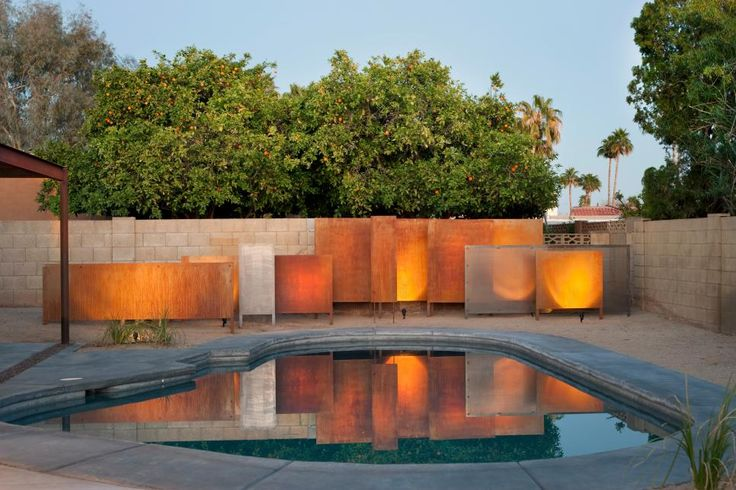 This modern home from Eric Spry features elements of Southwestern style as well as drought-tolerant landscaping. The home includes an attractive pool area and cantilevered entryway made from rusted metal.