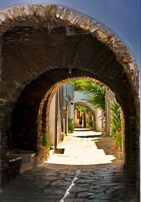 Arched alley. Steni, Tinos island, Cyclades, Greece.