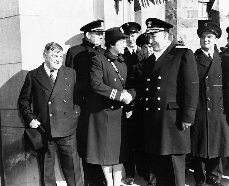 Commissioning ceremony, Female Officer Training School, Hunter College, Bronx, New York, United States, early 1943; note Mayor Fiorello La Guardia, Lt. Cmdr. Mildred McAfee, RAdm. Randall Jacobs