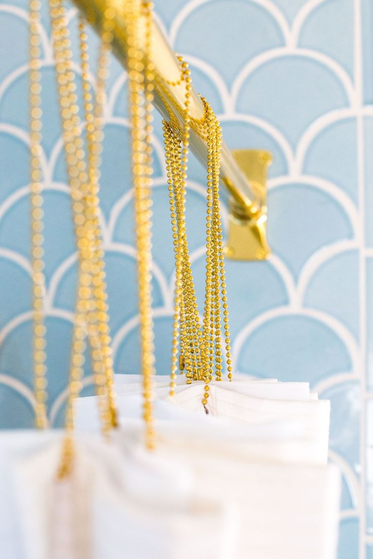Brass fixtures in the bathroom will give your space a simple, modern and feminine feel.
