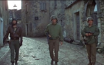 Kellys heroes (1970) Clint Estwood, Telly Savalas Donald Sutherland. Everytime I watch it, the theme song 'Burning Bridges' sticks with me for days.