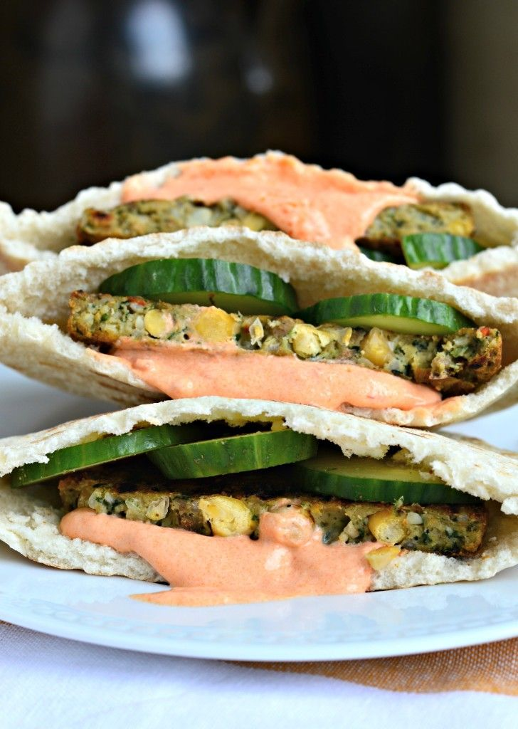 Chickpea burgers stuffed in a pita sandwich with cucumbers and a creamy harissa sauce - a healthy twist on dinner!