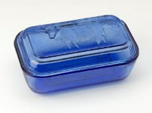 """Enjoy this beautiful large blue country cow butter dish from Niecey's Kitchen. - FREE SHIPPING - Blue glass butter dish - Cow Country design on top Measures 6.5"""" L x 5"""" W x 2"""" H - Holds one pound of b"""
