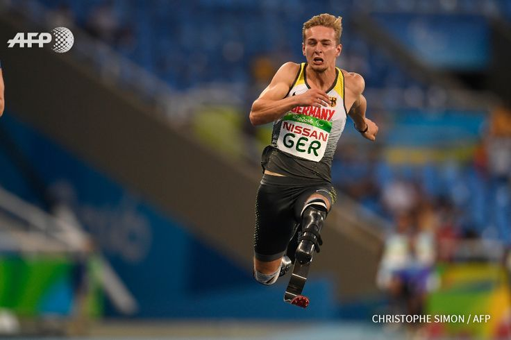 Johannes Floors competes in and wins with his team the 4X100M at the Olympic Stadium during the Paralympic Games in Rio de Janeiro, Brazil on September 12, 2016. CHRISTOPHE SIMON / AFP