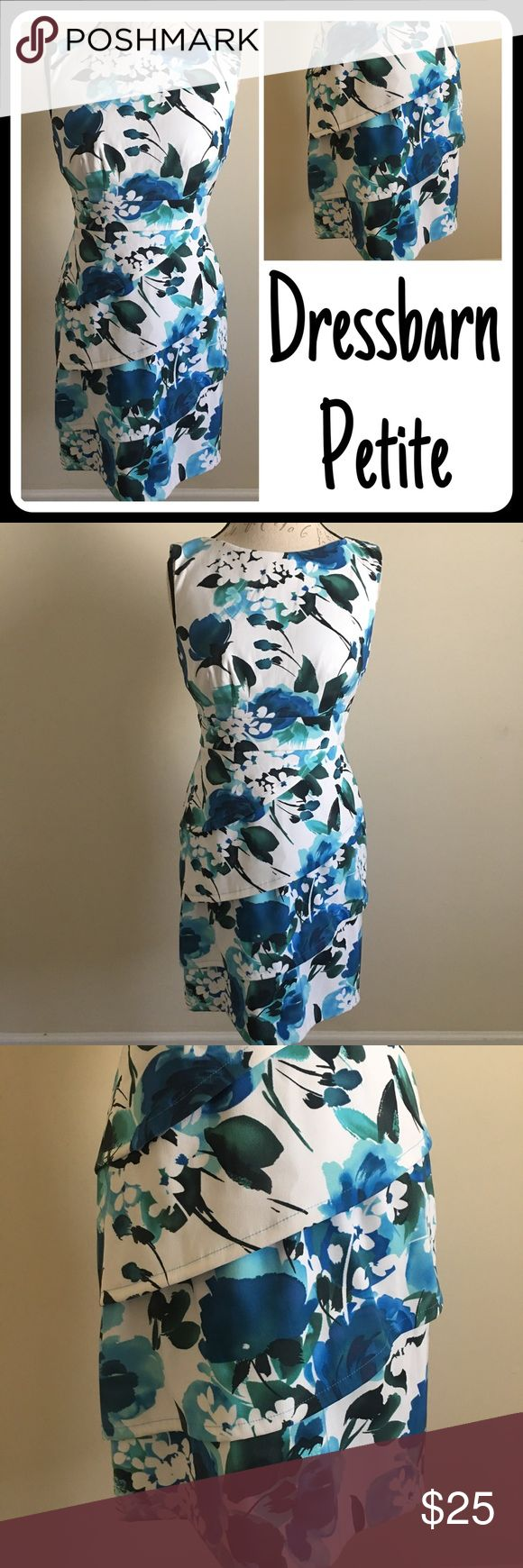 Dress Barn Blue & White Floral Dress Layered Skirt Dressbarn casual or career style dress.  Fitted A-line with a layered skirt.  White base with beautiful blue flower design through out.  Sleeveless dress with classic neckline.  Falls at knee.  Zip and clasp closure in back.  Size women's 4P Petite. Dress Barn Dresses Midi