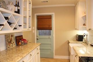 Giallo Ornamental granite, BM White Dove Cabinets, Martha Stewart Tidewater door, BM Shaker Beige wall color