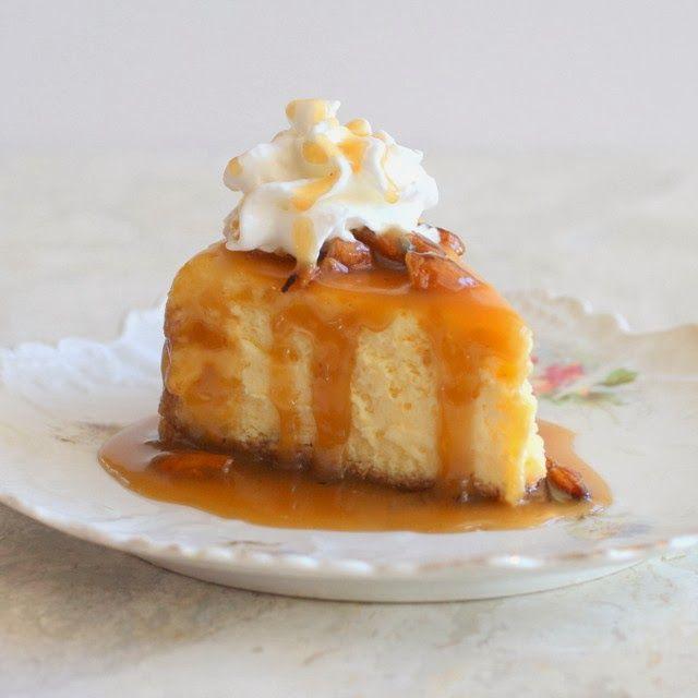 How's this for a Christmas dinner dessert?!  Eggnog Cheesecake with Honey Bourbon Praline Sauce