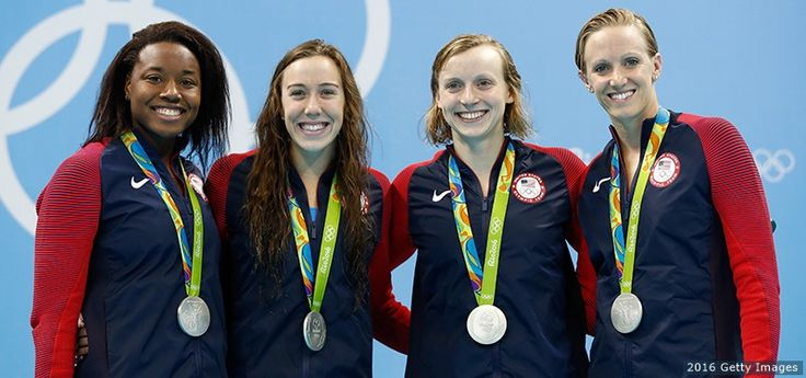 Silver medalists Simone Manuel, Abbey Weitzeil, Dana Vollmer and Kate Ledecky pose at the medal ceremony for the final of the women's 4x100-meter freestyle relay at the Rio 2016 Olympic Games at the Olympic Aquatics Stadium on Aug. 6, 2016 in Rio de Janeiro.