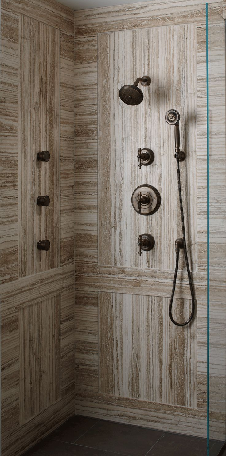 "ANN SACKS Crema Toscana 30"" x 72"" marble slab in honed finish with the following @Kallista Plumbing products: Inigo handshower, showerhead with arm, thermostatic valve trim, volume control valve trim and traditional turnsprays in weathered bronze"