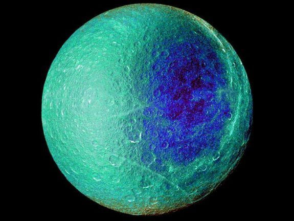 "Cassini Spacecraft Photos Show Saturn's 'Blue Moon' in All Its GloryCredit: NASA/JPL/SSIA false-color view of Saturn's moon Rhea captured by NASA's Cassini spacecraft on March 2, 2010. This image shows the side of the moon that always faces the planet. Ultraviolet, green and infrared images were combined into a single picture that isolates and maps regional color differences. This ""color map"" was then superimposed over a clear-filter image that preserves the relative brightness across the…"