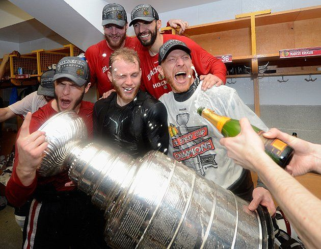 The Stanley Cup is held by MVP Patrick Kane and his friends, including a nearly unrecognizable Jonathan Toews and Marian Hossa, who appears to be getting attacked by ravenous champagne foam. We're especially fond of this photo because it appears to age Kane roughly 15 years.