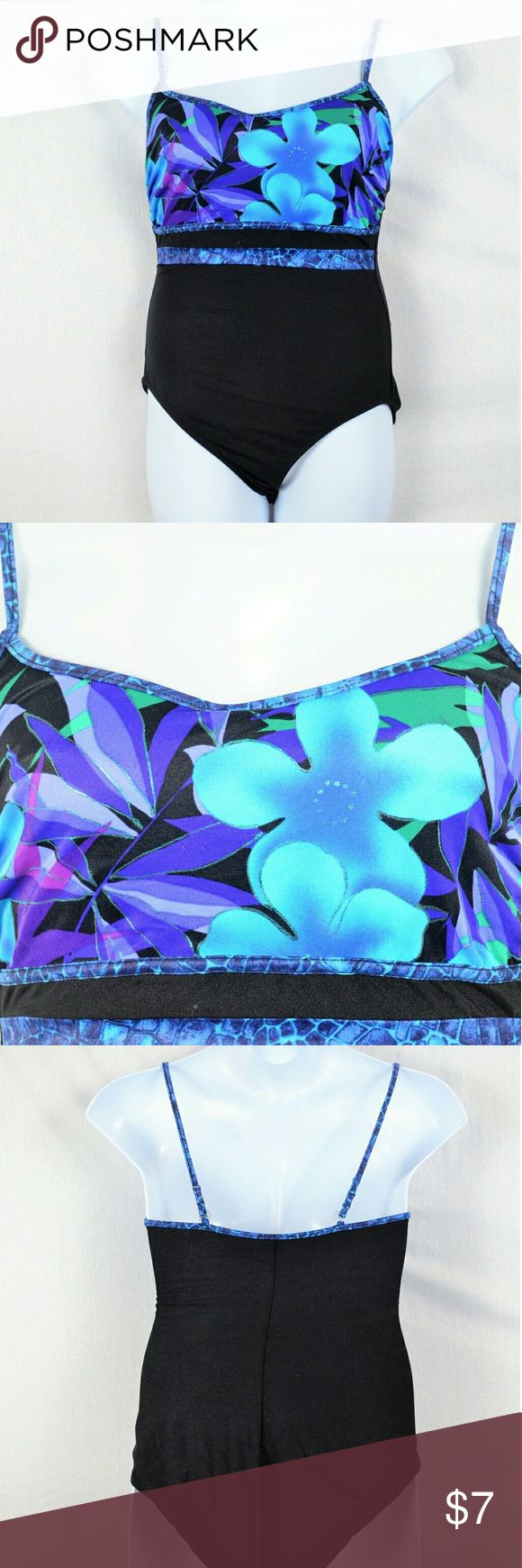 Size 14 Carol Wior 1 Piece Floral Bathing Suit This is a gorgeous 1 piece bathing suit from Carol Wior that is solid black on the bottom and on the back, and has bright blue flowers on the top with silver metallic trim.  The bra has beige lining with thin padding and the shoulder straps clasp on the back with clear clasps.  There are no flaws with this bathing suit, and it is size 14. #carolwior #1piecebathingsuit #floralbathingsuit #blackbathingsuit #metalliac #size14bathingsuit Carol Wior…