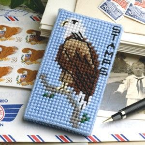 """Regal Eagle Stamp Book Cover Plastic Canvas ePattern - Graced by a majestic American eagle, our novel stamp book cover is a super way to protect your postage stamps. The handy cover also makes an attractive accessory for your purse, briefcase, or desk. The design is stitched using sport weight yarn, embroidery floss, and 10 mesh plastic canvas. Number of Designs: 1 stamp book cover Approximate Design Size: 2-1/8""""w x 3-3/4""""h x 1/4""""d"""