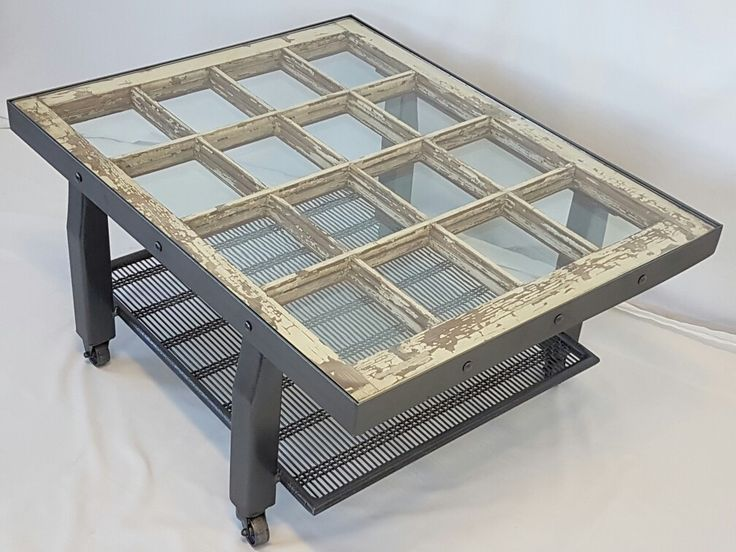 Unique coffee table with antique leaded glass window. Room between the glass and window to display pictures or treasures $695 Old Town Forge Old windows