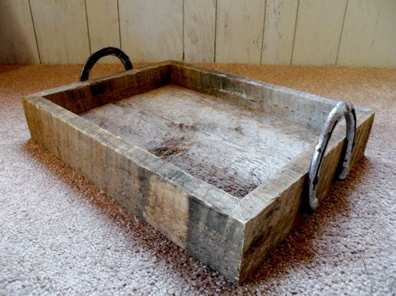 Yep gonna make one of these for sure!!!  It will cost 0$ lol  Reclaimed Barn Wood Serving Tray W/ Horse Shoe Handles. $50.00, via Etsy.