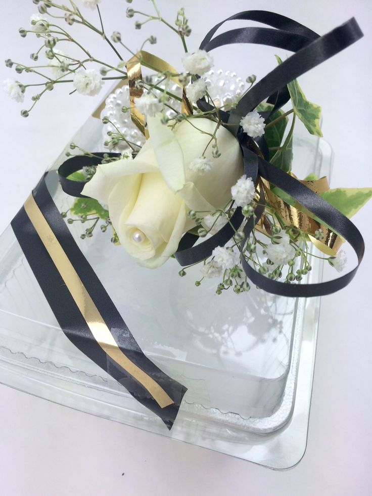 Beautiful white rose wrist corsage on a gorgeous pearl bracelet, wrist corsage, debs flowers, prom flowers, florist cork, unforgettable flowers cork