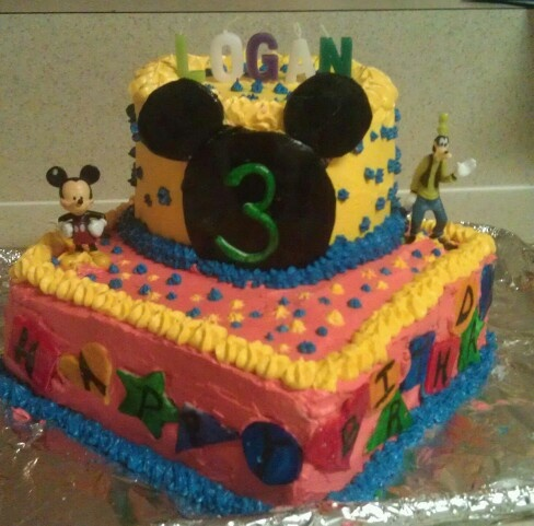 Logans mickey mousr birthday cake.. each cake has 3 layers. Red, green and blue!