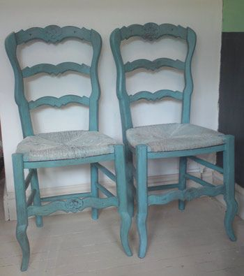 wo vintage French chairs in the Provencal design, painted with Provence and aged, with rush seats with a wash of Duck Egg Blue wash and a splash Old White. One of the seats has slightly imperfect rush seating but the other one is in good condtion.