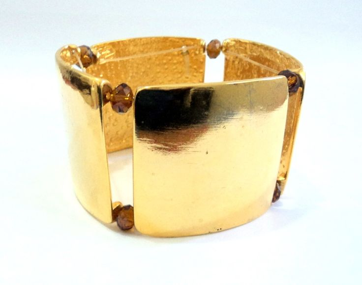 Cód: PUL378 <br> <br>Bracelete em banho de ouro com cristal.