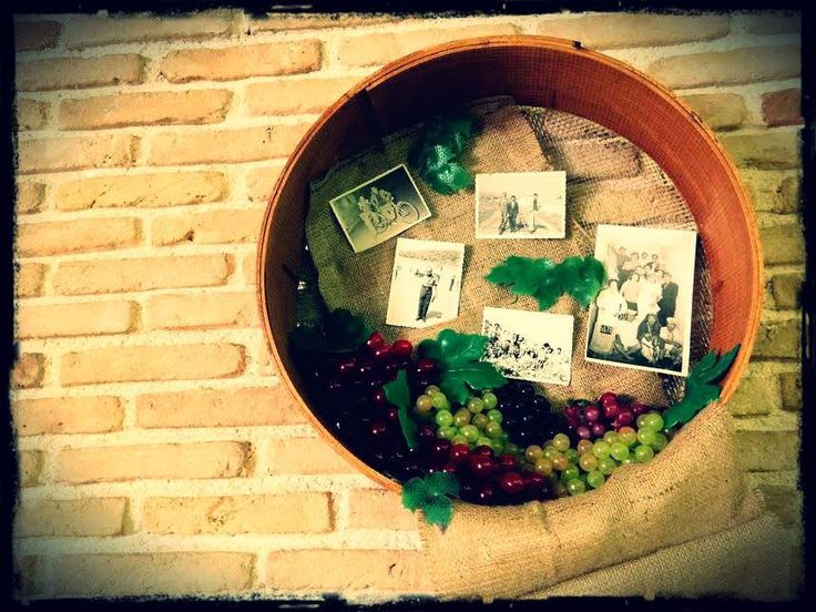 A sieve with grapes & photos..