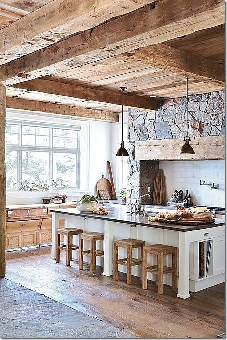 Love this kitchen...the soft grey windows with the white walls, reclaimed beams and stone...