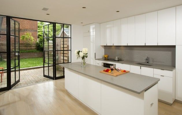 A design that integrates the great outdoors with the home- glass doors from the kitchen to the backyard make entertaining at home simple! It helps to have Pebble countertops too.