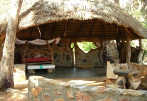 Kauro Guest House in the Sera Conservancy, Samburu is a self-catering facility with 2 en-suite bandas each with a double bed, central dining area and separate kitchen. The guest house is serviced by a cook, housekeeper and security is provided by the Conservancy scouts. Visitors must bring all food and drinks. The Guest House is hidden amongst Doum Palms on the edge of the Kauro lugga, a perfect oasis amidst the arid rangelands of the north.