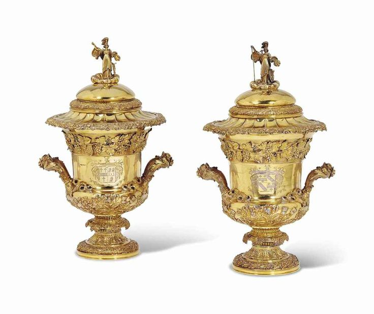 A PAIR OF GEORGE IV SILVER-GILT COMBINATION WINE-COOLERS AND CUPS AND COVERS WITH LINERS MARK OF REBECCA EMES AND EDWARD BARNARD, LONDON, 1822 Campana-shaped and on spreading oak leaf and acorn cast foot, the stem with cast fruiting grapevines, the lower