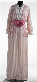 ~This full length summery day dress, circa 1910, is made from pink and white striped cotton, and has been designed to give the illusion that it is a blouse, pleated peplum jacket, and straight skirt. The false 'blouse', which is trimmed with lace, also functions as the lining of the bodice, whereas the skirt itself is unlined.~