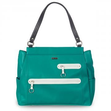 *Miche Canada* The beautiful Ryann Shell for Prima Bags conjures up images of white sand beaches, Caribbean waters, warm tropical breezes and brilliant sunshine. Bright turquoise faux leather is punctuated with two zippered front pockets, white detailing and rivet accents. Fun zipper pulls are ideal for decorating with one of our Charmers.