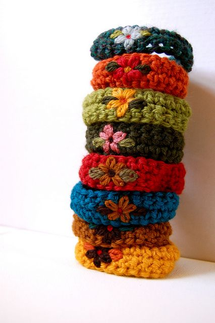 Crochet bracelets with embroidered flowers - pattern available from Adknits here…