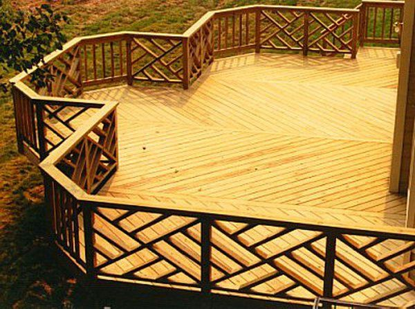 Stylish ornate wood railing. This creative idea with geometric shapes on the deck is really inspiring. The deck�s layout expresses movement and flow and gives a fantastic outstanding look to this area.