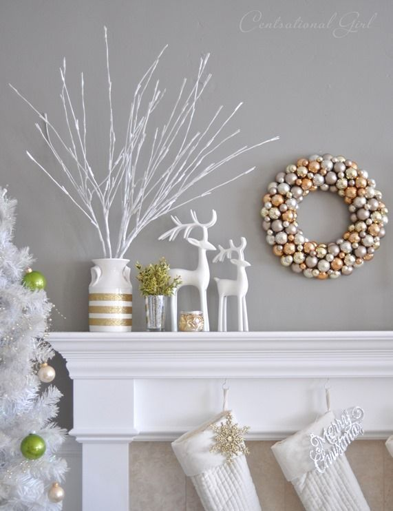 Winter white decor is paired beautifully with silver and gold accessories to complete a chic living room mantel. #decor #christmas