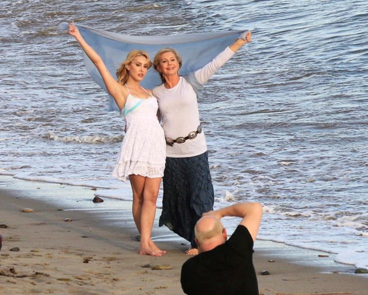 Olivia Newton John's daughter Chloe Rose Lattanzi is a mirror image of her famous mother as they pose during a photo shoot on the beach in Malibu. The mother-daughter pair looked strikingly similar, blessed with defined jawlines, high cheekbones and long blond hair, on March 9, 2014.