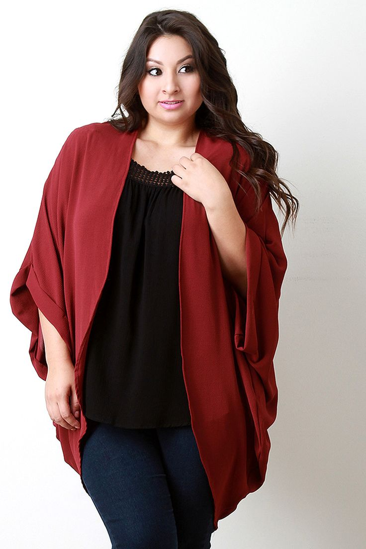 This plus size cardigan features a textured woven fabric, folded end dolman sleeves, open front draped construction, and high-low hemline. Accessories sold separately. Made in U.S.A. 100% Polyester..