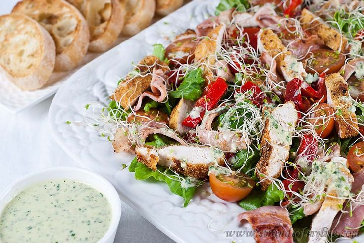 Jamie Oliver's Crispy Polenta Chicken Caesar Salad with a Creamy Yogurt-Based Dressing. From strandsofmylife.com