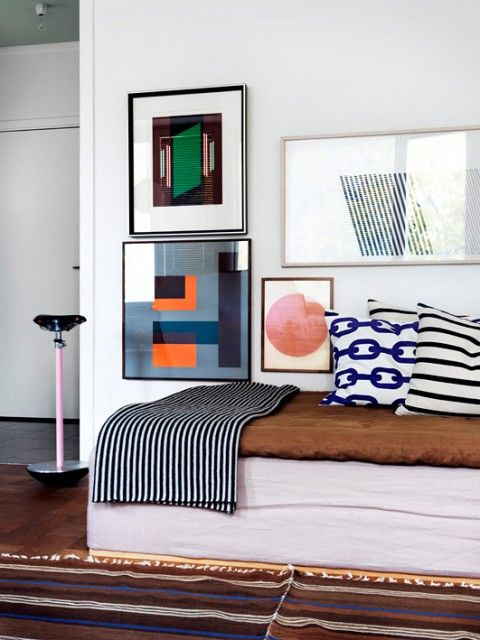 Sasa Antics home clean, modern and happy gallery wall and banquette