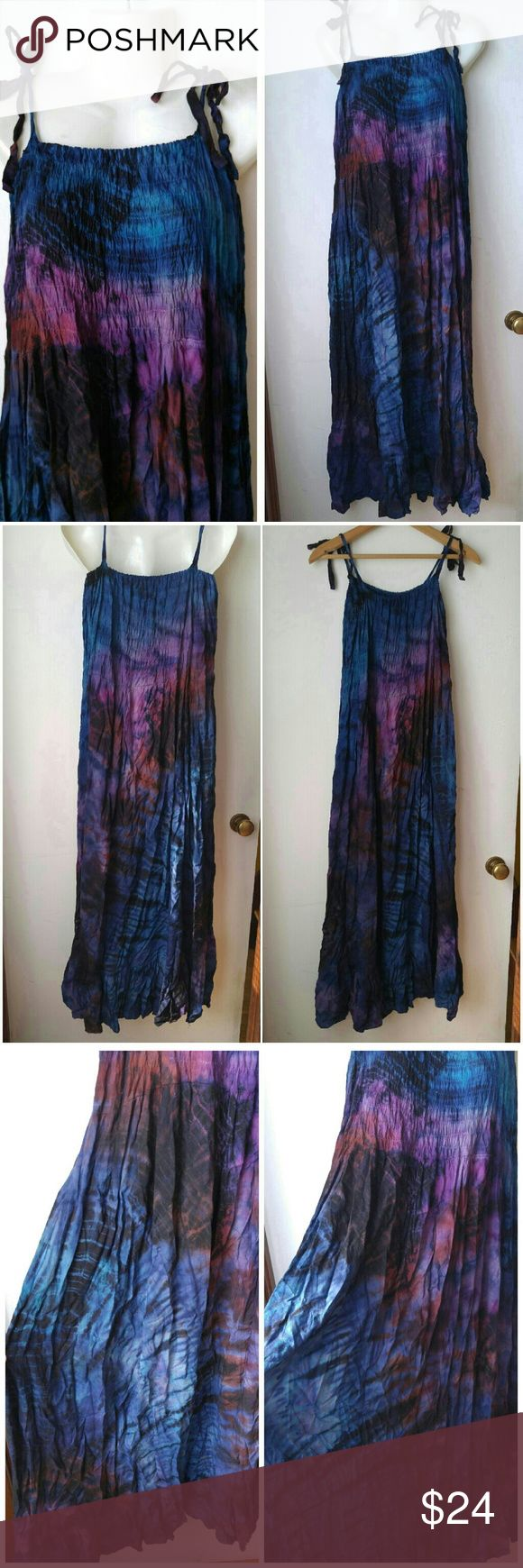 Galaxy tie dye dress boho blue osfm festival Gorgeous dress with vivid tie dye in shades of blue and violet looks like the night sky or outer space! Tie straps at shoulders allow to adjust for a perfect fit. Smocked bust section is stretchy and can fit a wide range of bust sizes. The skirt is floaty and free with a ruffly hem. In great condition with no issues, may have a few tiny threads loose and slightly wrinkled from storage.  More info is below in the comments! POSHCGALAXY888 Dresses…