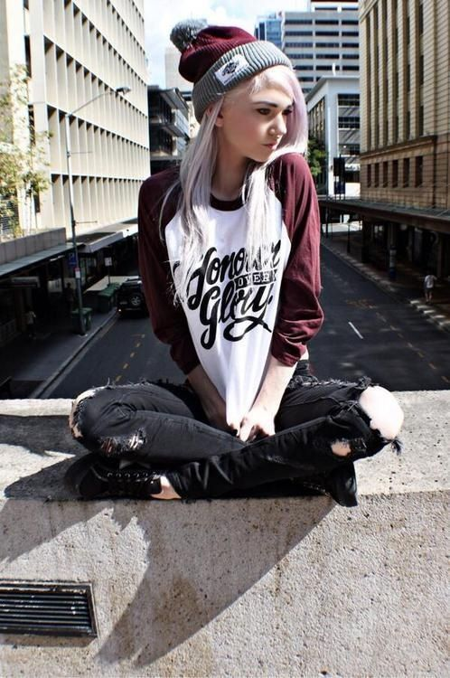 """black skinny jeans/pants or black tattered and torn skinny jeans, dark red and grey winter pom pom beanie, """"honor over glory"""" baseball style long sleeve shirt or sweatshirt with dark red sleeves and white body, and black converse tennies."""