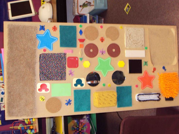 sensory board - I used things that can't get dirty so it will last longer, sandpaper to make different shapes and a bunch of other fun things :)