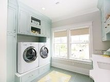 I would rather have real built-in drawers under the washer/dryer than the plastic pedestals they can come with. Also love this color for a laundry room