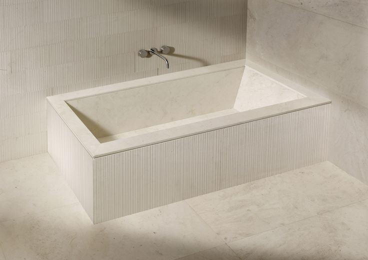 "Completely wrapped in natural stone, the Oyster bathtub could be described as a ""design your own tub"". With its beautifully simple structure, clean lines and 16 possible combinations of finish, it is the perfect starting point for a total look stone bathroom.  Available in Bianco Carrara, Crema d'Orcia, Pietra d'Avola and Silk Georgette® in Honed, Raw, Infinito or Bamboo finishes."