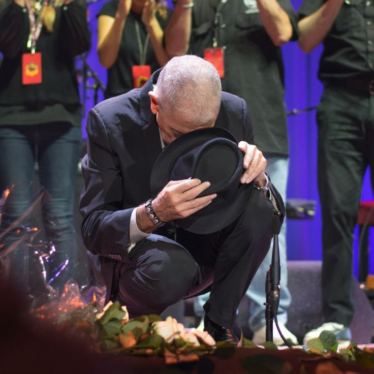 """This photo was taken on Friday 20th September 2013 in Amsterdam. It is the last moment of Leonard's last concert in Europe and a few hours before his 79th birthday.  By this gesture he is saying, """"Thank you friends for being here, it is deeply appreciated."""" To me, his gesture reflects how we regard Leonard now. Thank you Leonard, thanks for being here, it is deeply appreciated."""