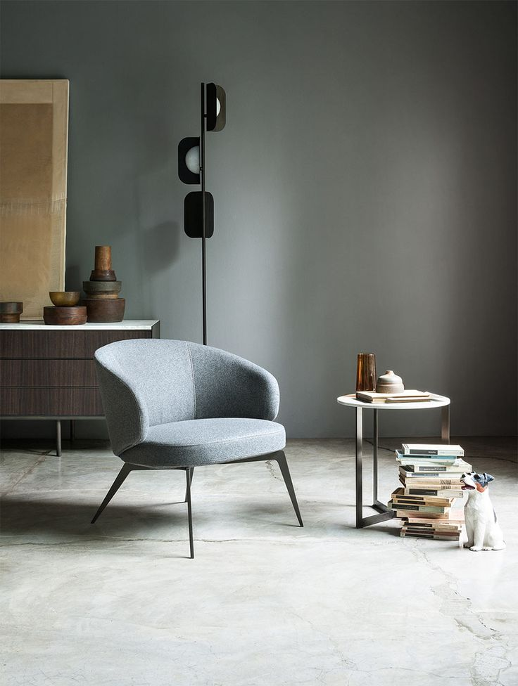 "Armchair designs: our top inspirations images | Bice by Lema.  A vintage-inspired armchair with a ""hugging"" silhouette is exactly what you need to daydream while reading romantic novels."